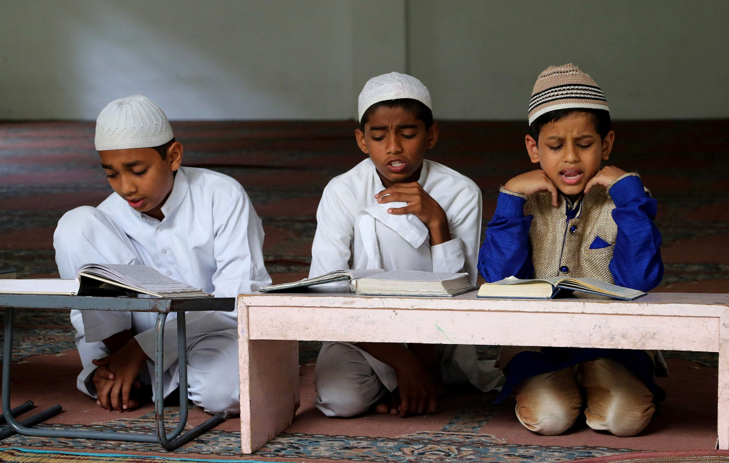 Indian Muslims study the Holy Quran in a madrasa