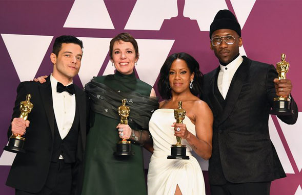 The 2019 Oscar winners: Rami Malek - Best Actor (Far-left), Olivia Colman - Best Actress (Middle-Left), Regina King – Best Supporting Actress (Middle Right), Mahershala Ali – Best Supporting Actor (Far-right)